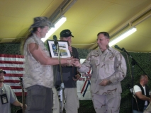 Ted Nugent accepting a plaque